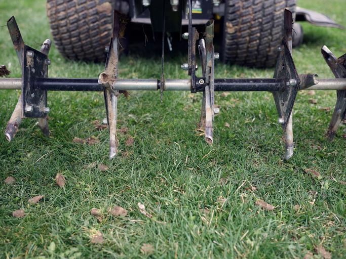 Tractor With Lawn Aerator Tool